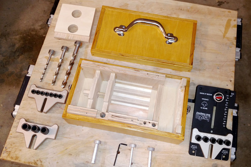 Empty Dowelling Jig Box with All of Its Contents Spread Around It